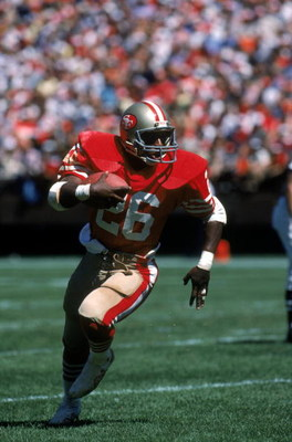 SAN FRANCISCO - SEPTEMBER 16:  Running back Wendell Tyler #26 of the San Francisco 49ers runs with the ball during a game against the New Orleans Saints at Candlestick Park on September 16, 1984 in San Francisco, California.  The 49ers won 30-20.  (Photo