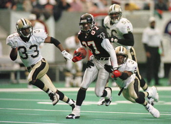 10 DEC 1995:  NEW ORLEANS SAINTS DEFENDERS TYRONE HUGHES #33, ERNEST DIXON #56 AND JIMMY SPENCER #37 ATTEMPT TO STOP ATLANTA FALCONS WIDE RECEIVER BERT EMANUEL #87 IN THE SECOND QUARTER AT THE GEORGIA DOME IN ATLANTA, GEORGIA.  Mandatory Credit: Matthew S