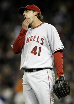 SEATTLE - APRIL 4:  Starting Pitcher John Lackey #41 of the Los Angeles Angels of Anaheim reacts after giving up a single in the fourth inning to Ichiro Suzuki of the Seattle Mariners on April 4, 2006 at Safeco Field in Seattle, Washington.  (Photo by Ott