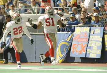22 Oct 1995:  Cornerback Tyronne Drakeford and linebacker Ken Norton of the San Francisco 49ers celebrate during the game against the St. Louis Rams at Busch Stadium in St. Louis, Missouri.  The 49ers won the game 44-10. Mandatory Credit: Jamie Squire  /A
