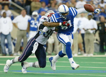 INDIANAPOLIS - NOVEMBER 30:  Marcus Pollard #81 of the Indianapolis Colts cannot control a pass intended for him while defended by Roman Phifer #95 of the New England Partiots on November 30, 2003 at the RCA Dome in Indianapolis, Indiana.  (Photo by Andy