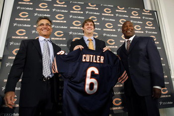 LAKE FOREST, IL - APRIL 3:  Chicago Bears general manager Jerry Angelo, quarterback Jay Cutler and head coach Lovie Smith are all smiles after introducing Cutler as their new quarterback during a press conference on April 3, 2009 at Halas Hall in Lake For