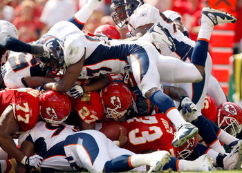 KANSAS CITY, MO - SEPTEMBER 28:  Larry Johnson #27 of the Kansas City Chiefs carries the ball up the middle at the goal line for a touchdown during the game against the Denver Broncos on September 28, 2008 at Arrowhead Stadium in Kansas City, Missouri.  (
