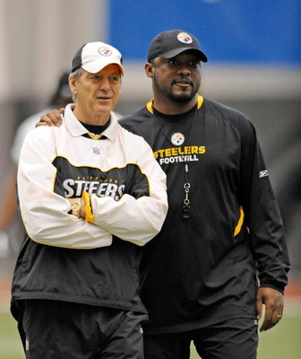 PITTSBURGH - MAY 01:  Head coach Mike Tomlin of the Pittsburgh Steelers watches practice alongside defensive coordinator Dick LeBeau during rookie training camp at the Pittsburgh Steelers Practice Facility on May 1, 2009 in Pittsburgh, Pennsylvania.  (Pho