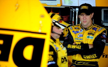 DOVER, DE - MAY 30:  Matt Kenseth, driver of the #17 DeWalt Ford, stands in the garage during practice for the NASCAR Sprint Cup Series Autism Speaks 400 at Dover International Speedway on May 30, 2009 in Dover, Delaware.  (Photo by Jeff Zelevansky/Getty 