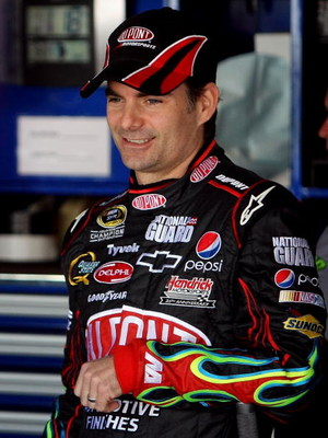 DOVER, DE - MAY 30:  Jeff Gordon, driver of the #24 DuPont Chevrolet, stands in the garage during practice for the NASCAR Sprint Cup Series Autism Speaks 400 at Dover International Speedway on May 30, 2009 in Dover, Delaware.  (Photo by Nick Laham/Getty I