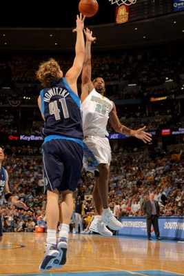 DENVER - MAY 13:  Anthony Carter #25 of the Denver Nuggets puts up a shot over Dirk Nowitzki #41 of the Dallas Mavericks in Game Five of the Western Conference Semifinals during the 2009 NBA Playoffs at Pepsi Center on May 13, 2009 in Denver, Colorado.  T