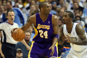 DENVER - MAY 29:  Kobe Bryant #24 of the Los Angeles Lakers posts up J.R. Smith #1 of the Denver Nuggets in Game Six of the Western Conference Finals during the 2009 NBA Playoffs at Pepsi Center on May 29, 2009 in Denver, Colorado. NOTE TO USER: User expr
