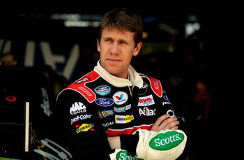 DOVER, DE - MAY 30:  Carl Edwards, driver of the #99 Aflac Ford, stands in the garage area during practice for the NASCAR Sprint Cup Series Autism Speaks 400 at Dover International Speedway on May 30, 2009 in Dover, Delaware.  (Photo by Jeff Zelevansky/Ge
