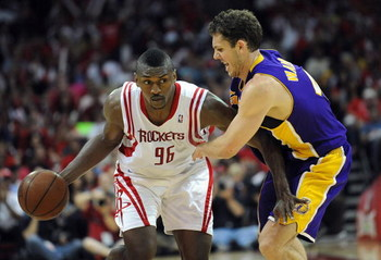 HOUSTON - MAY 10:  Guard Ron Artest #96 of the Houston Rockets dribbles the ball past Luke Walton #4 of the Los Angeles Lakers in Game Four of the Western Conference Semifinals during the 2009 NBA Playoffs at Toyota Center on May 10, 2009 in Houston, Texa