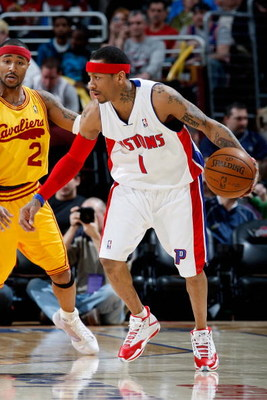 CLEVELAND - FEBRUARY 22:  Allen Iverson #1 of the Detroit Pistons moves past Mo Williams #2 of the Cleveland Cavaliers during the game on February 22, 2009 at the Quicken Loans Arena in Cleveland, Ohio.  The Cavaliers won 99-78.  NOTE TO USER: User expres