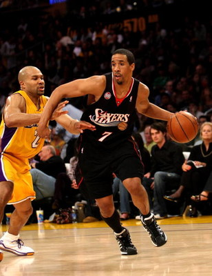 LOS ANGELES - MARCH 17:   Andre Miller #7 of the Philadelphia 76ers drives around Derek Fisher #3 of the Los Angeles Lakers on March 17, 2009 at Staples Center in Los Angeles, California.  The 76ers won 94-93.   NOTE TO USER: User expressly acknowledges a