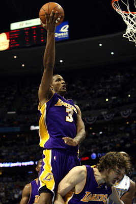 DENVER - MAY 23:  Trevor Ariza #3 of the Los Angeles Lakers goes up for a shot over teammate Pau Gasol #16 in the third quarter against the Denver Nuggets in Game Three of the Western Conference Finals during the 2009 NBA Playoffs at Staples Center on May