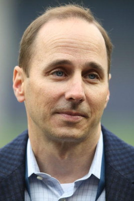 NEW YORK - APRIL 21:  General Manager of the New York Yankees, Brian Cashman on the field prior to the game against the Oakland Athletics on April 21, 2009 at Yankee Stadium in the Bronx borough of New York City.  (Photo by Nick Laham/Getty Images)