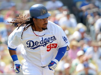 LOS ANGELES, CA - APRIL 19:  Manny Ramirez #99 of the Los Angeles Dodgers runs to first against the Colorado Rockies during the game at Dodger Stadium on April 19, 2009 in Los Angeles, California.  (Photo by Harry How/Getty Images)