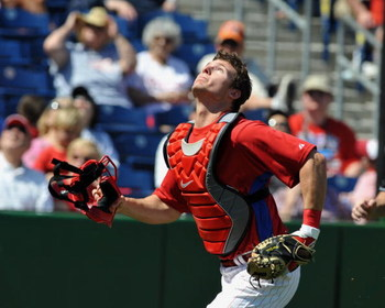 DUNEDIN, FL - MARCH 5:  Catcher Lou Marson #3 of the Philadelphia Phillies looks for a foul ball against Team USA  March 5, 2009 at Bright House Field in Dunedin, Florida.  (Photo by Al Messerschmidt/Getty Images)