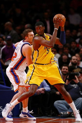 NEW YORK - FEBRUARY 23:  Roy Hibbert #55 of the Indiana Pacers goes up against David Lee #42 of the New York Knicks during the game at Madison Square Garden February 23, 2009 in New York City.  The Knicks won 123-119.  NOTE TO USER: User expressly acknowl
