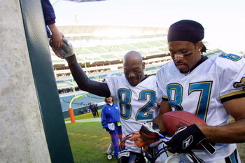 09 Dec 2001 : Keenan McCardell #87 and Jimmy Smith #82 of the Jacksonville Jaguars sign autographs after the game against the Cincinnati Bengals at Paul Brown Stadium in Cincinnati, Ohio. The Jaguars won 14-10. DIGITAL IMAGE. Mandatory Credit : Tom Pidgeo