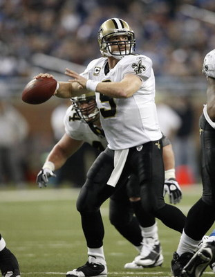 DETROIT - DECEMBER 21: Quarterback Drew Brees #9 of the New Orleans Saints drops back to pass in the third quarter against the Detroit Lions on December 21, 2008 at Ford Field in Detroit, Michigan. The Saints defeated the Lions 42-7.  (Photo by Leon Halip