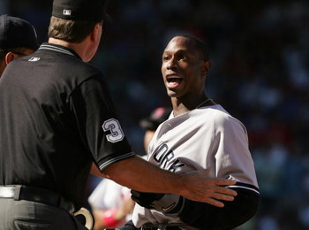 BOSTON - SEPTEMBER 26:  Outfielder Kenny Lofton #12 of the New York Yankees argues with an official during the game against Boston Red Sox on September 26, 2004 at Fenway Park in Boston Massachusetts. The Red Sox won 11-4.  (Photo by Al Bello/Getty Images
