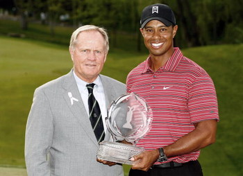 DUBLIN, OH - JUNE 07: Jack Nicklaus presents Tiger Woods with the trophy after his one-stroke victory at the Memorial Tournament at the Muirfield Village Golf Club on June 7, 2009 in Dublin, Ohio. (Photo by Scott Halleran/Getty Images)