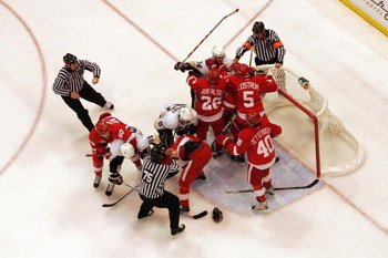 DETROIT - JUNE 06:  Referees try to break up a fight between the Pittsburgh Penguins and the Detroit Red Wings during Game Five of the 2009 NHL Stanley Cup Finals at Joe Louis Arena on June 6, 2009 in Detroit, Michigan.  (Photo by Bruce Bennett/Getty Imag