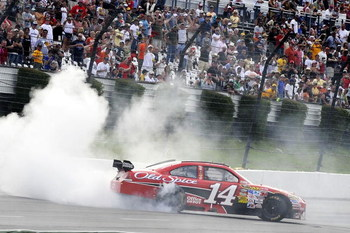 LONG POND, PA - JUNE 07:  Tony Stewart, driver of the #14 Office Depot/Old Spice Chevrolet does a burnout after winning the NASCAR Sprint Cup Series Pocono 500 on June 7, 2009 at Pocono Raceway in Long Pond, Pennsylvania.  (Photo by John Harrelson/Getty I