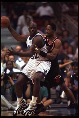 28 Feb 1996: Center Shaquille O'Neal of the Orlando Magic moves against center Alonzo Mourning of the Miami Heat during a game played at the Orlando Arena in Orlando, Florida. The Magic won the game, 116-112.