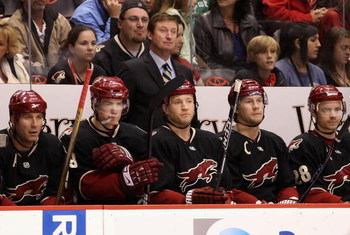 GLENDALE, AZ - APRIL 11:  Head coach Wayne Gretzky of the Phoenix Coyotes looks on with teammates on the bench during the NHL game against the Anaheim Ducks at Jobing.com Arena on April 11, 2009 in Glendale, Arizona. The Coyotes defeated the Ducks in 5-4