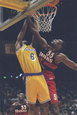 10 Nov 1996:  Guard Eddie Jones of the Los Angeles Lakers drives to the basket as center Dkembe Mutombo of the Atlanta Hawks tries to block him during a game at the Great Western Forum in Inglewood, California.  The Lakers won the game 92-85. Mandatory Cr