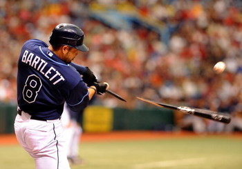 ST. PETERSBURG, FL - MAY 3: Shortstop Jason Bartlett #8 of the Tampa Bay Rays breaks a bat against the Boston Red Sox May 3, 2009 at Tropicana Field in St. Petersburg, Florida. (Photo by Al Messerschmidt/Getty Images)