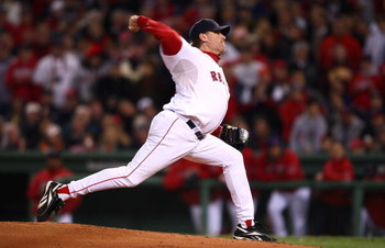 BOSTON - OCTOBER 25:  Curt Schilling #38 of the Boston Red Sox pitches against the Colorado Rockies during Game Two of the 2007 Major League Baseball World Series at Fenway Park on October 25, 2007 in Boston, Massachusetts.  (Photo by Elsa/Getty Images)