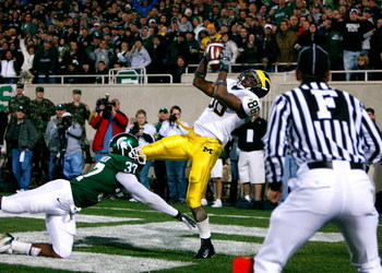EAST LANSING, MI - NOVEMBER 03:  Receiver Mario Manningham #86 of the Michigan Wolverines pulls in the game-winning touchdown against cornerback Ross Weaver #37 of the Michigan State Spartans during the second half at Spartan Stadium November 3, 2007 in E