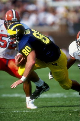 12 Sep 1998:  Tight end Jerame Tuman #80 of the Michigan Wolverines in action during the game against the Syracuse Orangemen at the Michigan Stadium in Ann Arbor, Michigan. The Orangemen defeated the Wolverines 38-28. Mandatory Credit: Vincent Laforet  /A