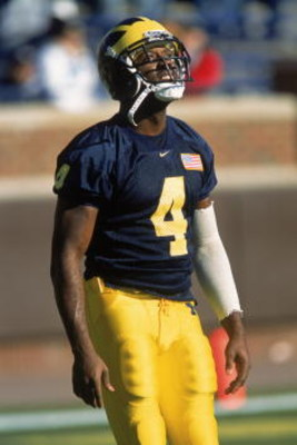 10 Nov 2001:  Wide Receiver Marquise Walker #4 of the Michigan Wolverines watching the ball in the air during the game against the Minnesota Golden Gophers at the Michigan Stadium in Ann Arbor, Michigan. The Wolverines defeated the Golden Gophers 31-10. M