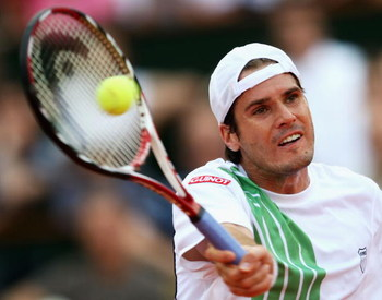 PARIS - JUNE 01:  Tommy Haas of Germany hits a forehand during the Men's Singles Fourth Round match against Roger Federer of Switzerland on day nine of the French Open at Roland Garros on June 1, 2009 in Paris, France.  (Photo by Clive Brunskill/Getty Ima