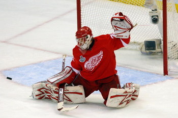 DETROIT - JUNE 06:  Goaltender Chris Osgood #30 of the Detroit Red Wings saves a shot on goal by the Pittsburgh Penguins during Game Five of the 2009 NHL Stanley Cup Finals at Joe Louis Arena on June 6, 2009 in Detroit, Michigan.  (Photo by Jim McIsaac/Ge