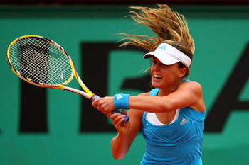 PARIS - MAY 29:  Michelle Larcher De Brito of Portugal  hits a backhand during the Women's Singles Third Round match against Aravane Rezai of France on day six of the French Open at Roland Garros on May 29, 2009 in Paris, France.  (Photo by Ryan Pierse/Ge