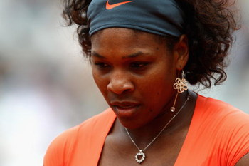 PARIS - MAY 26:  Serena Williams of USA looks on during the Women's First Round match against Klara Zakopalova of Czech Republic on day three of the French Open at Roland Garros on May 26, 2009 in Paris, France.  (Photo by Ryan Pierse/Getty Images)