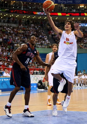 BEIJING - AUGUST 24:  Ricky Rubio #6 of Spain lays the ball up past Dwight Howard #11 of the United States in the gold medal game during Day 16 of the Beijing 2008 Olympic Games at the Beijing Olympic Basketball Gymnasium on August 24, 2008 in Beijing, Ch