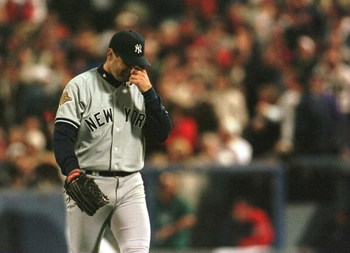 23 Oct 1996:  Pitcher Kenny Rogers of the New York Yankees walks back to the mound after giving up 4 runs  to the Atlanta Braves in the fourth inning of game four of the World Series at Fulton County Stadium in Atlanta, Georgia. Mandatory Credit: Doug Pen