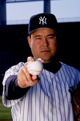 26 Feb 1999:  Pitcher Hideki Irabu #14 of the New York Yankees poses for the camera on Photo Day during Spring Training at Legends Field in Tampa, Florida. Mandatory Credit: Vincent Laforet  /Allsport