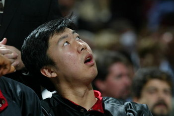 SACRAMENTO, CA -  JANUARY 13:  Wang Zhizhi #15 of the Miami Heat watches the game against the Sacramento Kings during the game on January 13, 2004 at Arco Arena in Sacramento, California.  The Kings won 90-86.   NOTE TO USER: User expressly acknowledges a