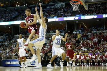MEMPHIS, TN - MARCH 29:  Blake Griffin #23 of the Oklahoma Sooners jumps into Tyler Hansbrough #50 of the North Carolina Tar Heels in the second half during the NCAA Men's Basketball Tournament South Regional Final at the FedExForum on March 29, 2009 in M