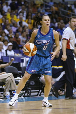 LOS ANGELES - AUGUST 24:  Jennifer Azzi #8 of the Utah Starzz handles the ball in Game two of the Western Conference Finals against the Los Angeles Sparks during the 2002 WNBA Playoffs on August 24, 2002 at Staples Center in Los Angeles, California. The S