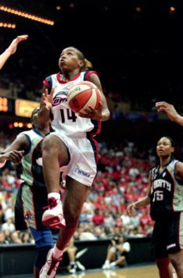26 Aug 2000:  Cynthia Cooper #14 of the Houston Comet drives up to the basket for a lay up during the game against the New York Liberty in the WNBA Finals Game at the Compaq Center in Houston, Texas. The Comets defeated the Liberty 79-73 in overtime.  NOT