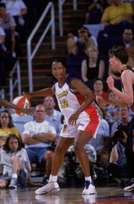 4 Jul 2001:  Jennifer Gillom #22 of the Phoenix Mercury dribbling the ball during the WNBA game against the Miami Sol at the America West Arena in Phoenix, Arizona. The Mercury defeated the Sol 60-47.  NOTE TO USER: It is expressly understood that the onl