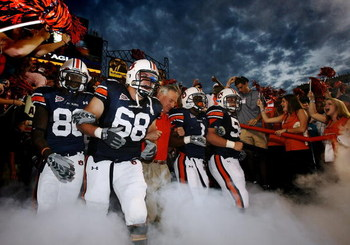 AUBURN, AL - SEPTEMBER 20: Offensive lineman Jason Bosley #68 of the Auburn Tigers leads head coach Tommy Tuberville and the rest of his team out of the tunnel before taking on the LSU Tigers missed a field goal at Jordan-Hare Stadium on September 20, 200