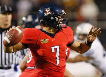 LAS VEGAS - DECEMBER 20:  Quarterback Willie Tuitama #7 of the Arizona Wildcats looks to throw a pass against the Brigham Young University Cougars during the Pioneer Las Vegas Bowl at Sam Boyd Stadium December 20, 2008 in Las Vegas, Nevada. Arizona won 31