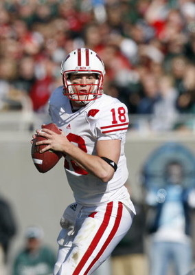 EAST LANSING - NOVEMBER 1:  Quarterback Dustin Sherer #18 of the  Wisconsin Badgers looks to pass the ball during the game against the Michigan State Spartans at Spartan Stadium on November 1, 2008 in East Lansing, Michigan. (Photo by: Gregory Shamus/Gett
